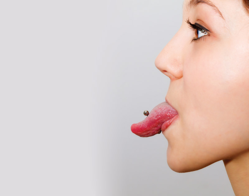 article about tooth and gum health surrounding tongue piercing