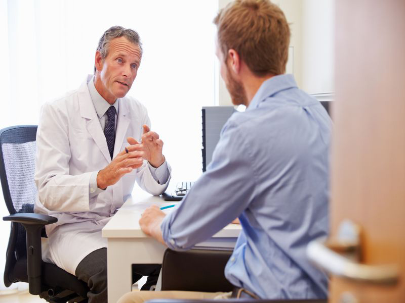 Men Discussing Cancer Risk with Doctor